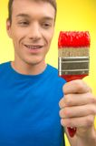 Painter closeup view looking at brush. Stock Photos
