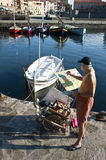 Painter Collioure France. A painter on the harbour wall painting a scene across the harbour Royalty Free Stock Photography