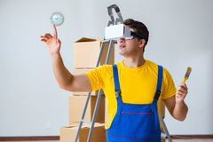 The painter contractor working with virtual reality goggles. Painter contractor working with virtual reality goggles Stock Images