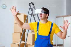 The painter contractor working with virtual reality goggles. Painter contractor working with virtual reality goggles Royalty Free Stock Photo
