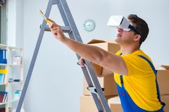 The painter contractor working with virtual reality goggles Stock Photography