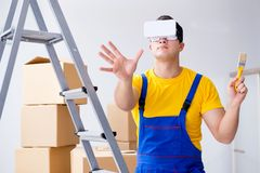 The painter contractor working with virtual reality goggles Royalty Free Stock Photos