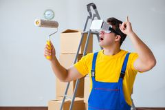 The painter contractor working with virtual reality goggles. Painter contractor working with virtual reality goggles Royalty Free Stock Images