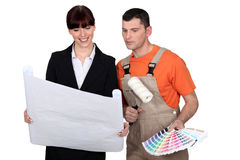 Painter and decorator. Checking over plans Royalty Free Stock Photos