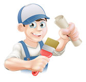 Painter decorator training. Painter decorator with certificate, qualification or other scroll and paint brush. Education concept for being professionally Stock Photography