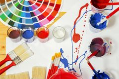 Painter and decorator work table with house project, color swatches. stock photography