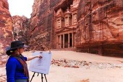 Painter drawing the  facade of ancient Petra, Jordan Stock Photos