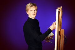 Painter and easel Stock Photography