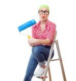 Painter female. Amazed woman with roller ready for wall painting or new home renovating, isolated on white Stock Images