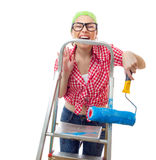 Painter female. Expressive woman holding roller afore ladder over white background Royalty Free Stock Photo