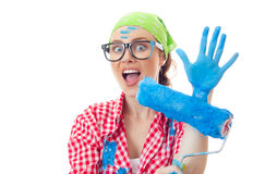 Painter female. Funny amazed woman with roller ready for wall painting or new home renovating, isolated on white Stock Image