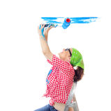 Painter female. Happy woman painting a wall an blue color, isolated on white. Worker female holding paint roller and renovating new home Stock Image