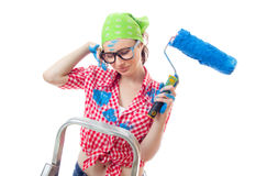 Painter female. Sad woman with paint roller, isolated on white. Lazy female worker on renovation or wall painting Royalty Free Stock Photography