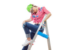 Painter female. Sleepy or tired woman with paint roller, isolated on white. Lazy female worker on renovation or wall painting Stock Photography