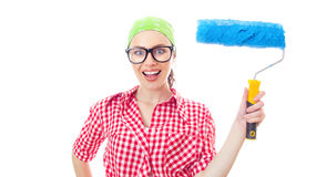 Painter female. Surprised woman holding paint roller, girl ready for renovating or wall painting ,isolated on white Stock Photo