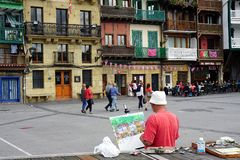 Painter in front of colorful historic houses in pasaia basque country stock photo