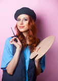 Painter girl with brush and palette Royalty Free Stock Photo