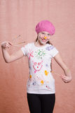 Painter girl in a decorated shirt Stock Photo