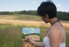 Painter-girl en plein air Stock Images