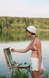 Painter-girl en plein air Stock Image