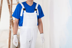 Painter with gloves Stock Photo