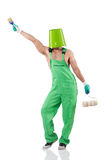 Painter in green coveralls Royalty Free Stock Image