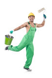 Painter in green coveralls Royalty Free Stock Photography