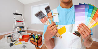 Painter hand with painting brush. Professional man painter hand with brush. House renovation Stock Photo