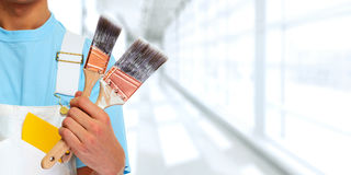Painter hand with painting brush Royalty Free Stock Image