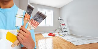 Painter hand with painting brush. Professional man painter hand with brush. House renovation Royalty Free Stock Photos