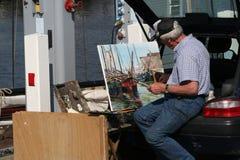 Painter in Harlingen. Netherlands, Harlingen,-june 2016 Street-view Royalty Free Stock Photo