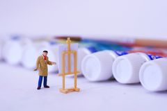 A painter and his paint. A painter working in front of his colors paint Stock Photography