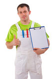 Painter holding a clipboard and thumb up Royalty Free Stock Photography