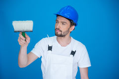 Painter holding a paint brush Royalty Free Stock Image