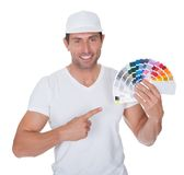 Painter holding a paint roller and spectrum Stock Photo