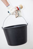Painter holding paintbrushes and bucket Stock Photography