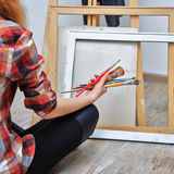 Painter holds the brush Royalty Free Stock Image