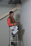 Painter on a job Stock Image