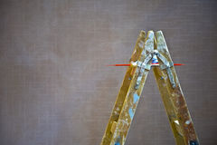 Painter ladder. With Colored pencils on gray wall background Stock Images