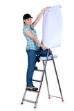 Painter on a ladder Stock Image