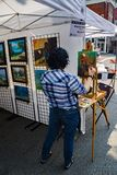 Painter at the 61th Annual Sidewalk Art Show royalty free stock photo
