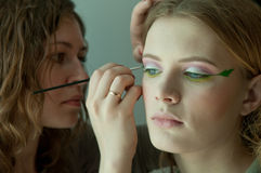 A painter making a faceart Stock Photography