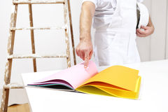 Painter man choose color from samples Stock Image