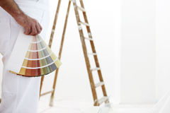 Painter man with color swatches in your hand  Royalty Free Stock Photography
