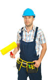 Painter man holding paint roller Royalty Free Stock Images