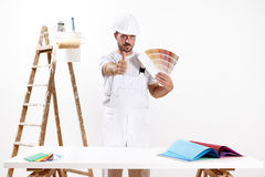 Painter man like hand, concept choose color from samples Stock Photos