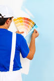 Painter man looking a color palette Royalty Free Stock Photos