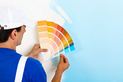 Painter man looking a color palette Stock Photos