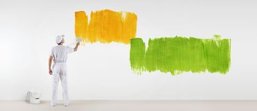 Painter man with paint brush painting colors samples, isolated o. N blank white wall background, web banner Stock Image