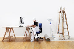 Painter man research on the network, supplies painting Royalty Free Stock Photography